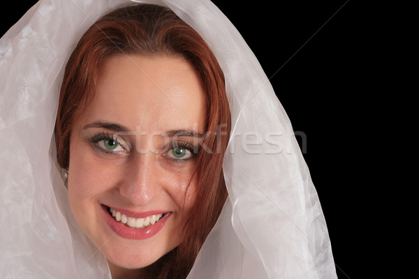 Ethereal green eyed young woman in white veil Stock photo © Photoline