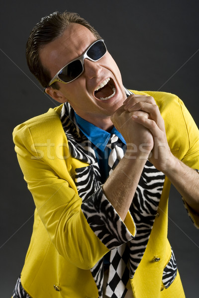 rockabilly singer from 1950s in yellow jacket Stock photo © Photoline