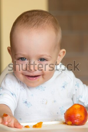 curious baby boy examines a peach Stock photo © Photoline