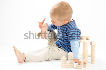 Kicsi aranyos fiú játszik tömbházak izolált Stock fotó © Photoline