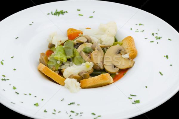 Printemps légumes ragoût blanche plaque noir Photo stock © Photooiasson