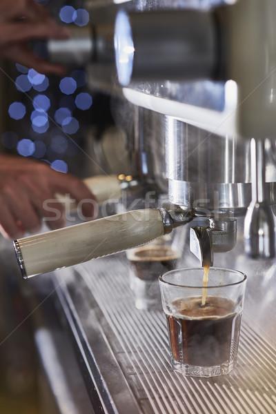 Barista making a espresso with a classic Italian coffee machine. Stock photo © Photooiasson
