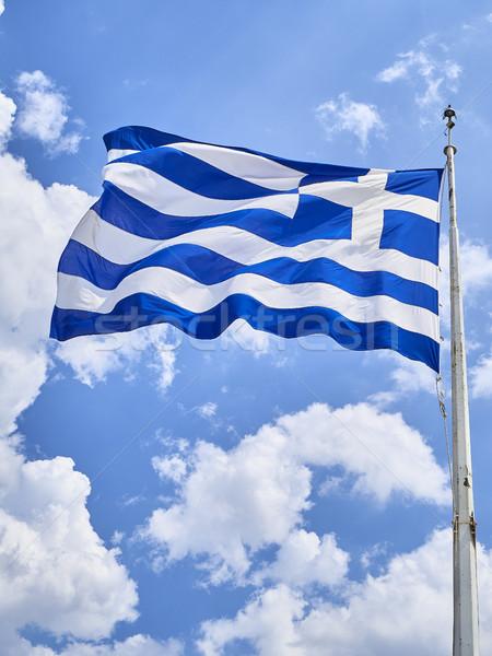 Flag of Greece waving on a blue sky. Stock photo © Photooiasson