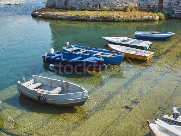 Fishing boats moored in fishing port of Gallipoli. Puglia. Stock photo © Photooiasson