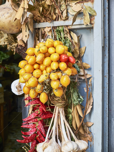 Piennolo tomatoes bunch in a greengrocer stall. Naples, Italy. Stock photo © Photooiasson