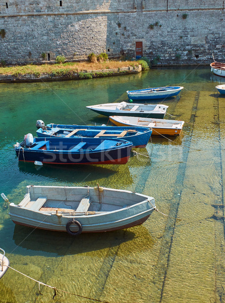 Fishing boats moored in fishing port of Gallipoli. Puglia. Stock photo © Photooiasson