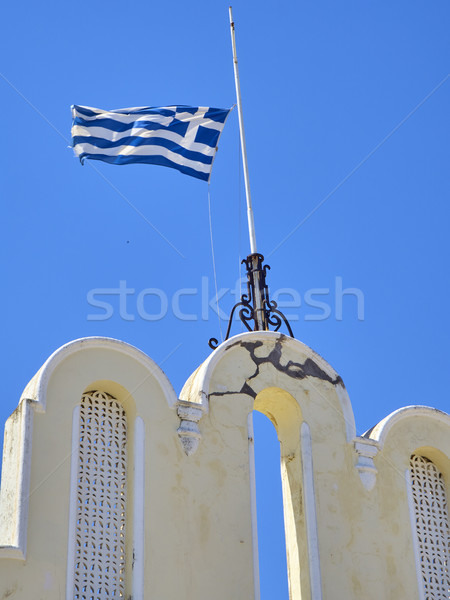 Flag of Greece waving on a blue sky. Stock photo © Photooiasson
