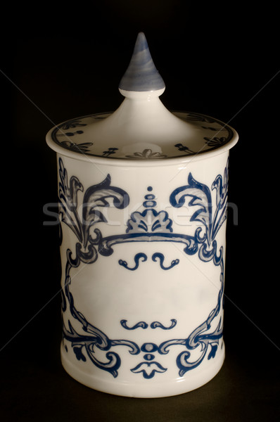 Antique ceramic canister on black background. Typical in Europea Stock photo © Photooiasson
