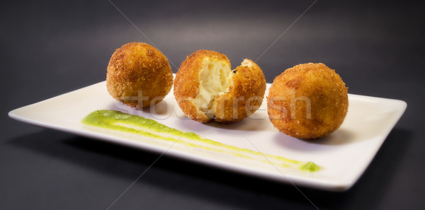 Creamy and smooth fried croquettes. Typical Spanish tapa. Stock photo © Photooiasson