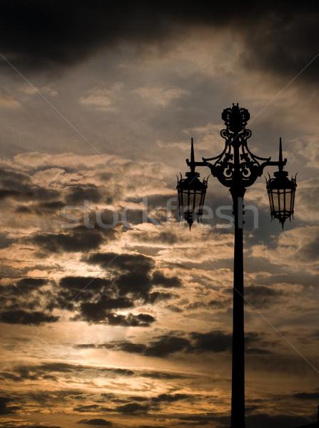 Naplemente égbolt sziluett felhők utca fém Stock fotó © Photooiasson