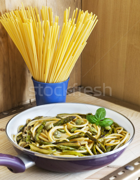 Bucatini with seasonal vegetables in a frying pan Stock photo © Photooiasson
