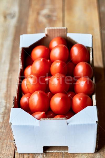 Ripe Plum tomatoes in a market cardboard box Stock photo © Photooiasson