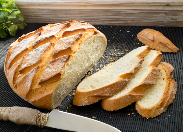Sliced rustic loaf. Stock photo © Photooiasson