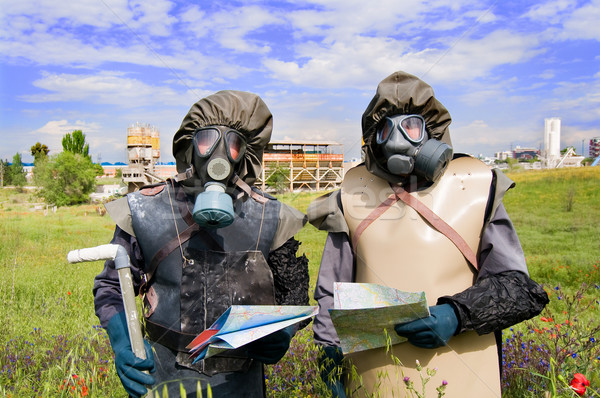 Nuclear protection crew in old protective suits and gas mask Stock photo © Photooiasson