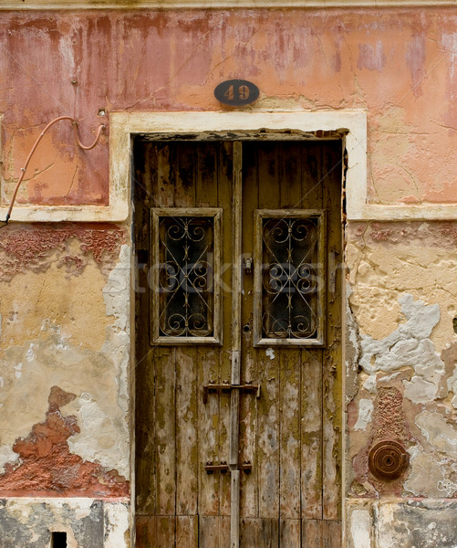 Antique door in a house with worn stone wall texture. Stock photo © Photooiasson