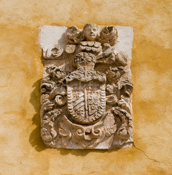Heráldica piedra escudo casco querubín pared Foto stock © Photooiasson