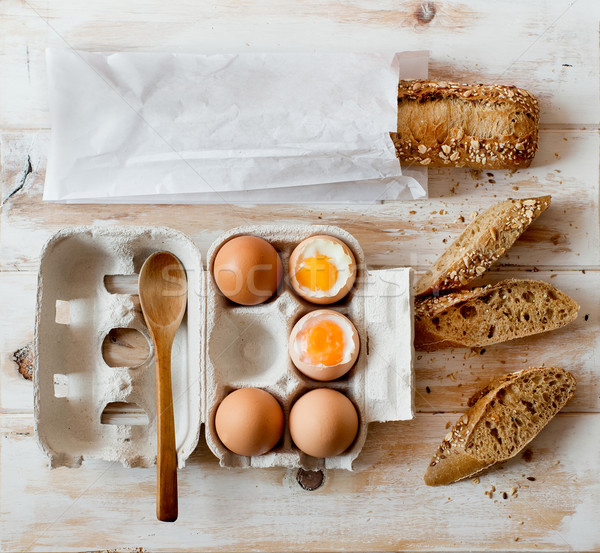Soft boiled eggs and wholemeal bread. Stock photo © Photooiasson