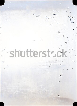 Steel panel of a kitchen splashed with water. Stock photo © Photooiasson