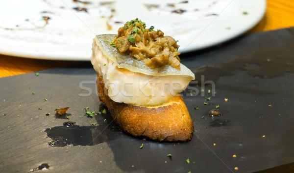 Typical spanish codfish pincho. Stock photo © Photooiasson