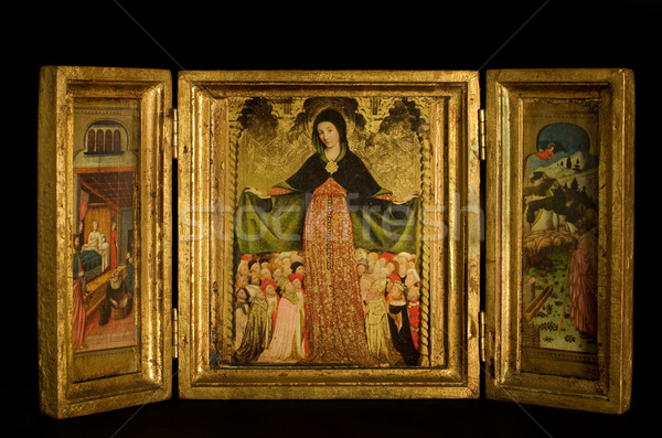 Triptych with Virgin and Child flanked by archangels, scenes from the life of Christ, on black backg Stock photo © Photooiasson