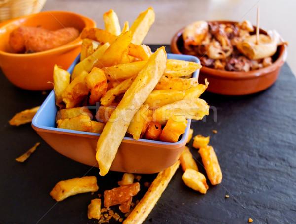Charakteristisch spanisch Tapas frites Tintenfisch Restaurant Stock foto © Photooiasson