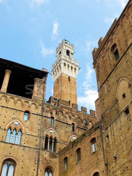 Palazzo Pubblico with Mangia tower in background. Siena, Italy Stock photo © Photooiasson