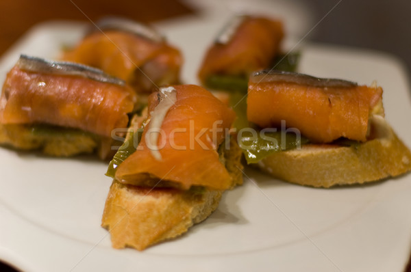 Typical Pintxo or Tapa (Salmon and Cantabrian Anchovy) from Spain Stock photo © Photooiasson