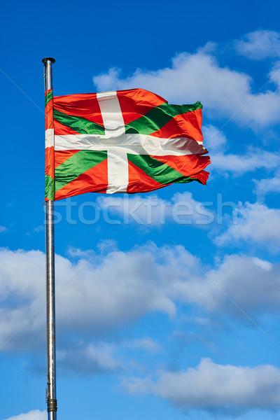 Ikurrina, Basque Country flag waving on a blue sky. Stock photo © Photooiasson