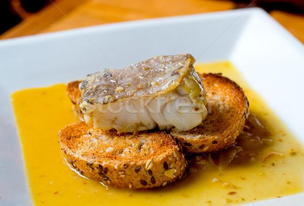 Typique espagnol cuit faible température poissons Photo stock © Photooiasson