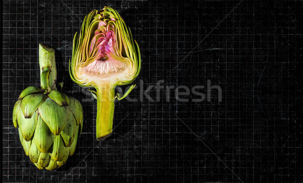 Artichokes on a antique chalkboard. Stock photo © Photooiasson