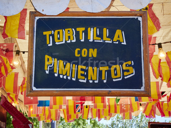 Vintage wooden signboard at a fair announcing Spanish Omelette with peppers. Stock photo © Photooiasson