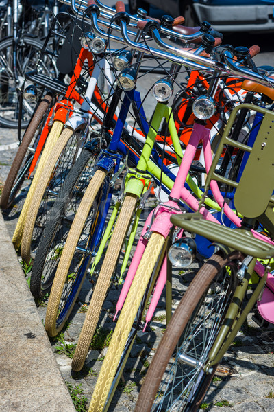 Colored bicycles parked in a european street. Stock photo © Photooiasson