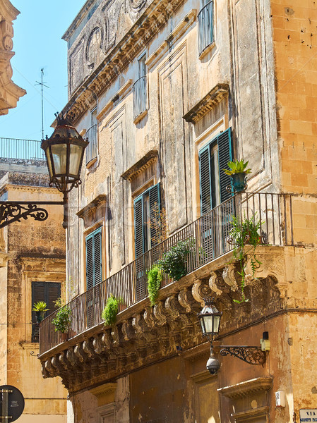 Balcony of a baroque palace in Lecce, Puglia. Stock photo © Photooiasson