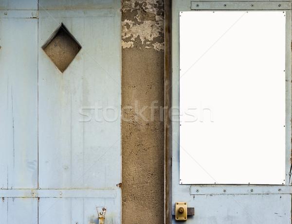Antique bleu bois portes blanche panneau Photo stock © Photooiasson