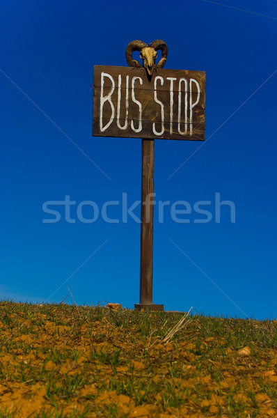 Bus stop post against blue sky. Stock photo © Photooiasson
