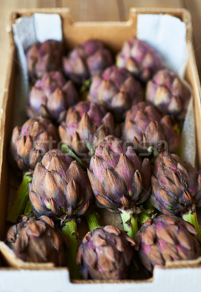 Fresh purple artichokes in a cardboard box. Stock photo © Photooiasson