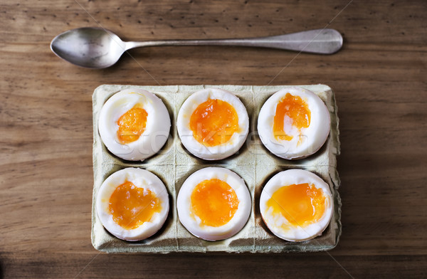 Half a dozen soft boiled eggs. Stock photo © Photooiasson