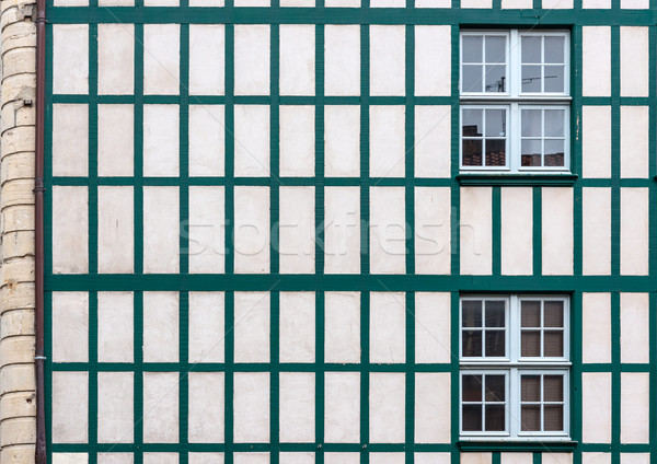 Windows on a white wall with old wooden beams. Stock photo © Photooiasson