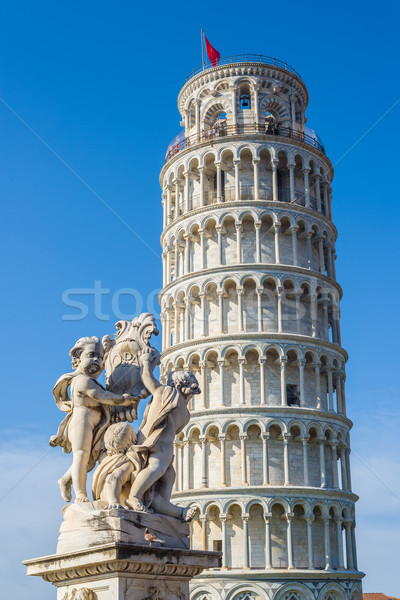 Fontana dei Putti with leaning tower in background. Pisa, Italy Stock photo © Photooiasson