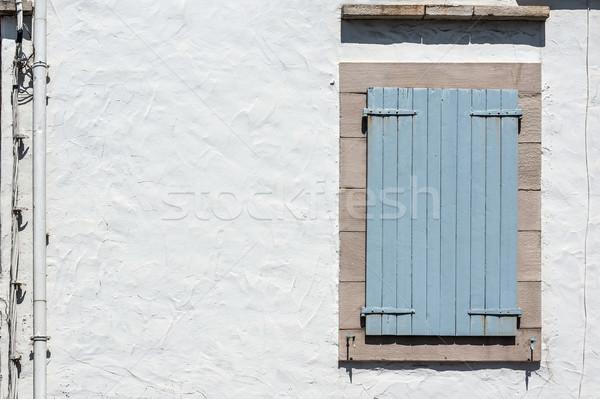 Bleu bois fenêtre fermé panneau rouillée Photo stock © Photooiasson