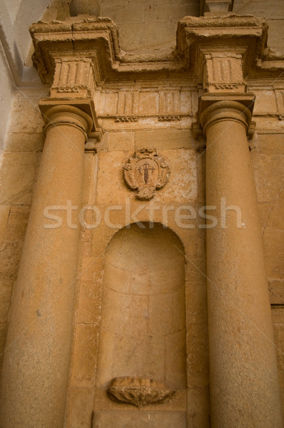 Paired columns with a Santiago shield in a classic church entry. San Antonio Abad church in El Tobos Stock photo © Photooiasson