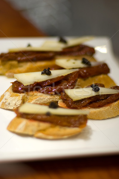 Typical Pintxo or Tapa (Dry Tomato with truffle) from Spain Stock photo © Photooiasson