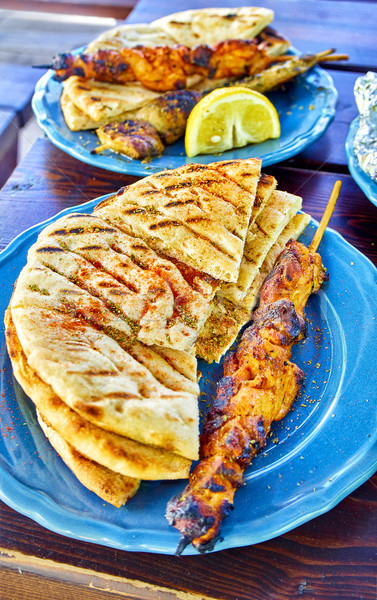 Spiced Chicken Souvlakis with seasoned pita bread. Typical greek Stock photo © Photooiasson