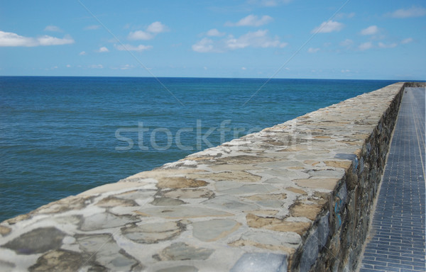 Stone wall in marine stroll Stock photo © Photooiasson