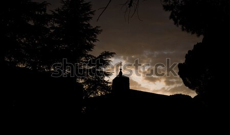 Bell Tower Silhouette of a Medieval Chapel Stock photo © Photooiasson