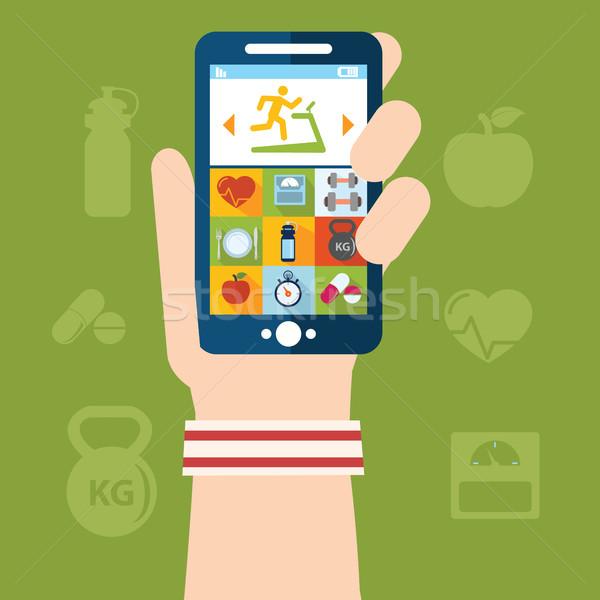 Kéz tart telefon súlyemelés alkalmazás szív Stock fotó © Photoroyalty