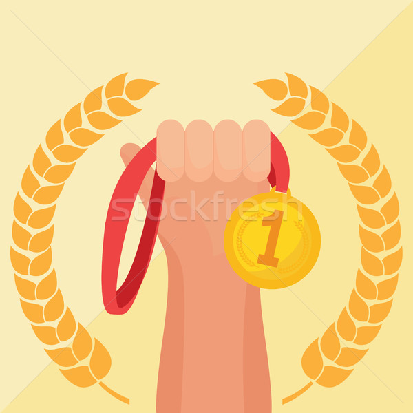 Hand holding golden medal champion prize winner reward. Stock photo © Photoroyalty