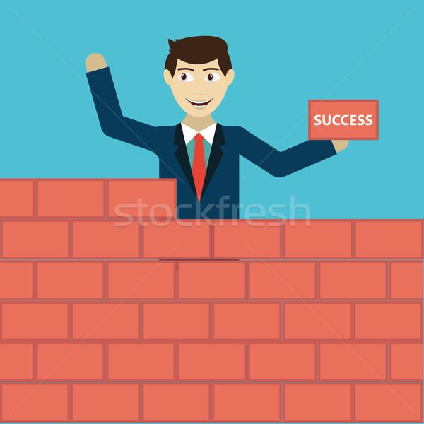 Businessman building a brick wall of success Stock photo © Photoroyalty