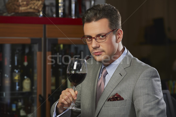 Wealthy man toasting with wine Stock photo © photosebia