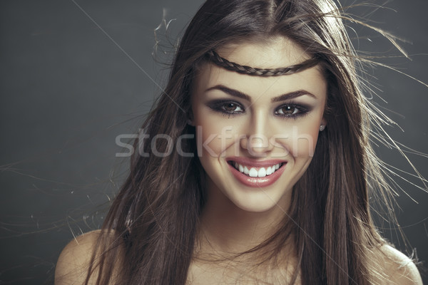 Smiling woman with blowing hair strands Stock photo © photosebia